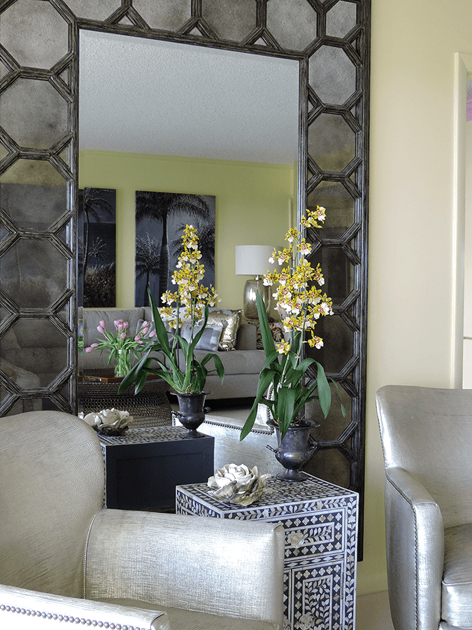 photo of a sitting nook with sofa chair and accent table and mirror