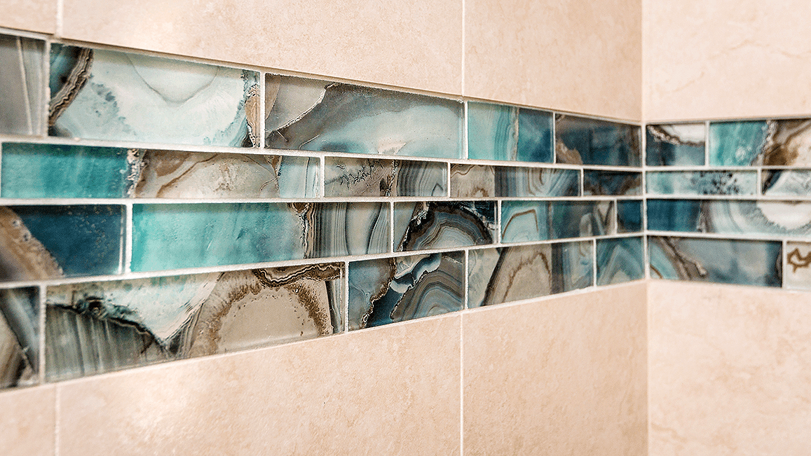 green tile with swirls of blue green and earth tones