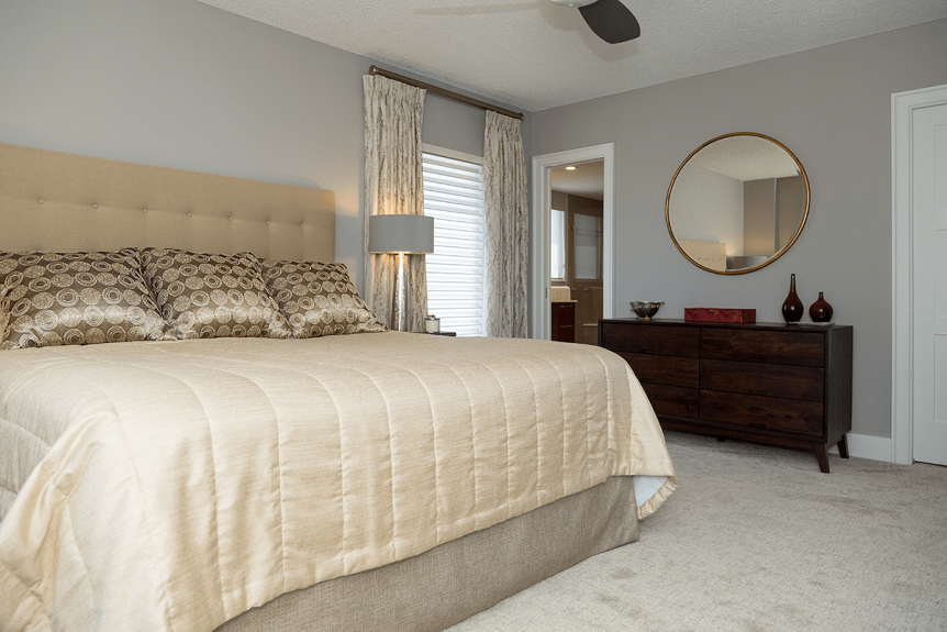 neutral toned bedroom with large king bed and custom drapery