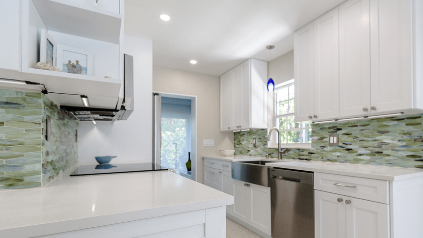 white countertops and cabinets of a galley kitchen