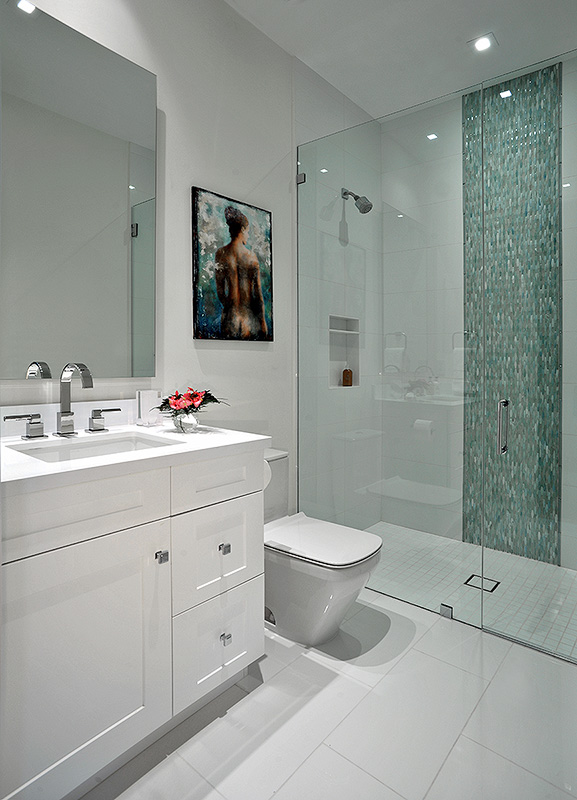 Florida style guest bathroom with green tiles in a stand-in shower