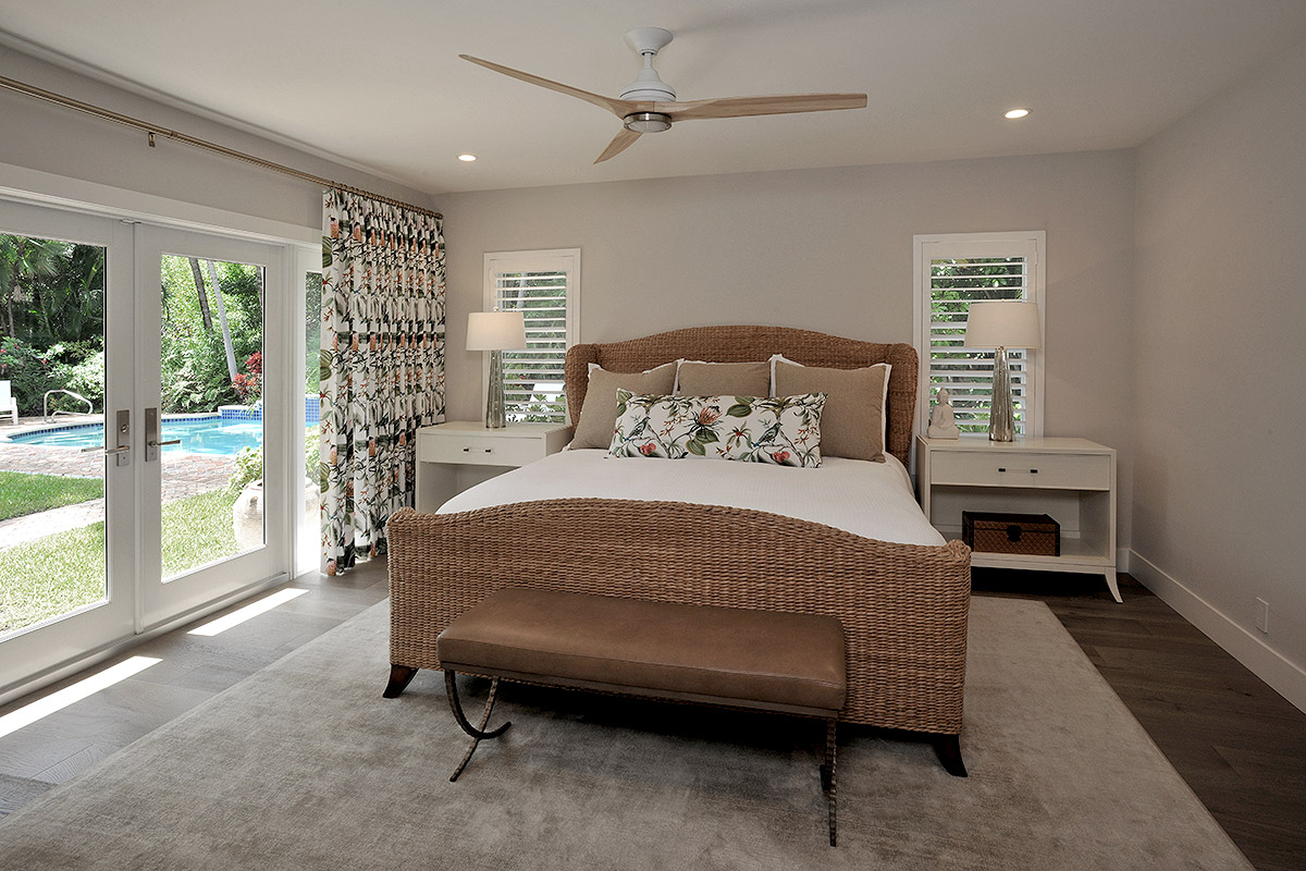 coastal style master bedroom with wicker bed in earth tones