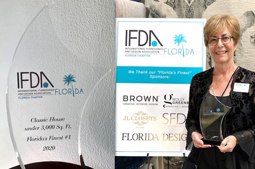 Janet Ireland of Flourish Delray Design receiving IFDA award for Florida's finest homes
