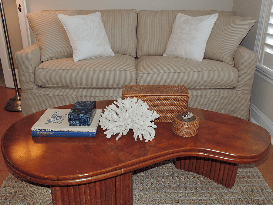 sofa and coffee table in neutral tones in a coastal living room