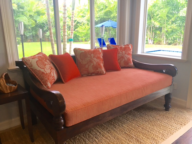 upholstered settee with designer fabric in red orange tones