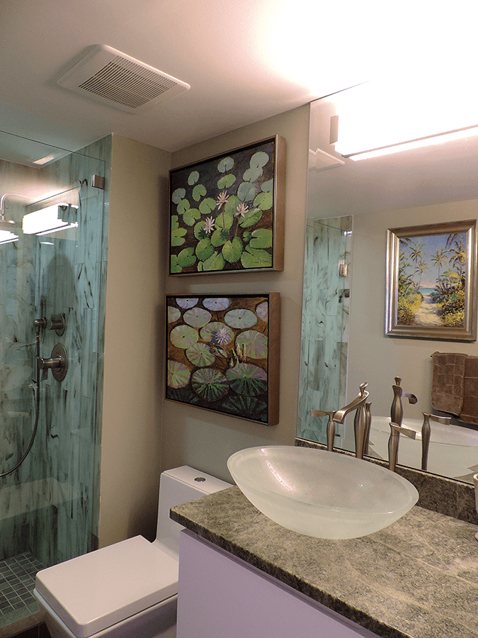 bathroom with artwork and bowl sink
