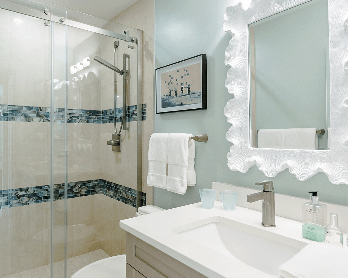 guest bath with white sink and white framed mirror