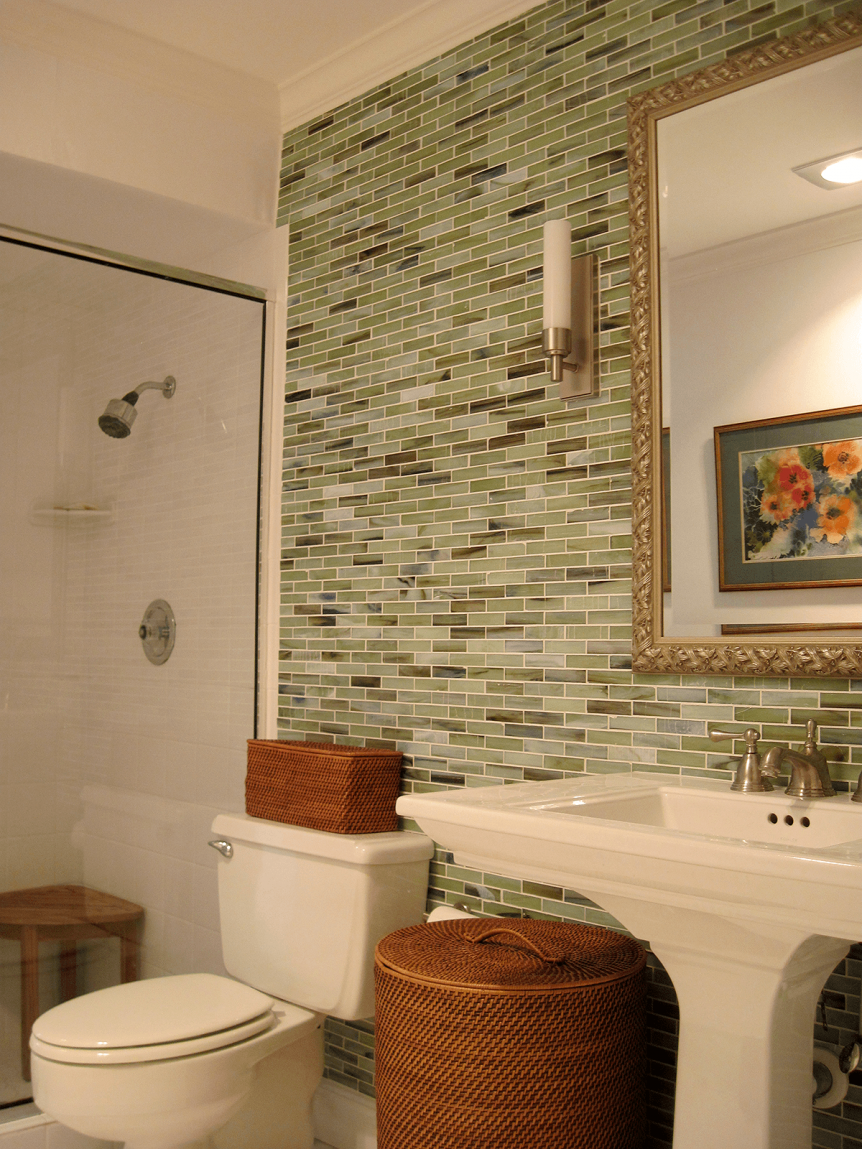 guest bath with green glass tile