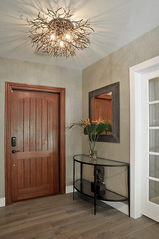 entry way with organic looking lighting