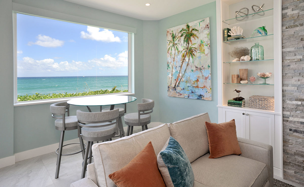 Close up of the living room of a beach house showing breakfast area