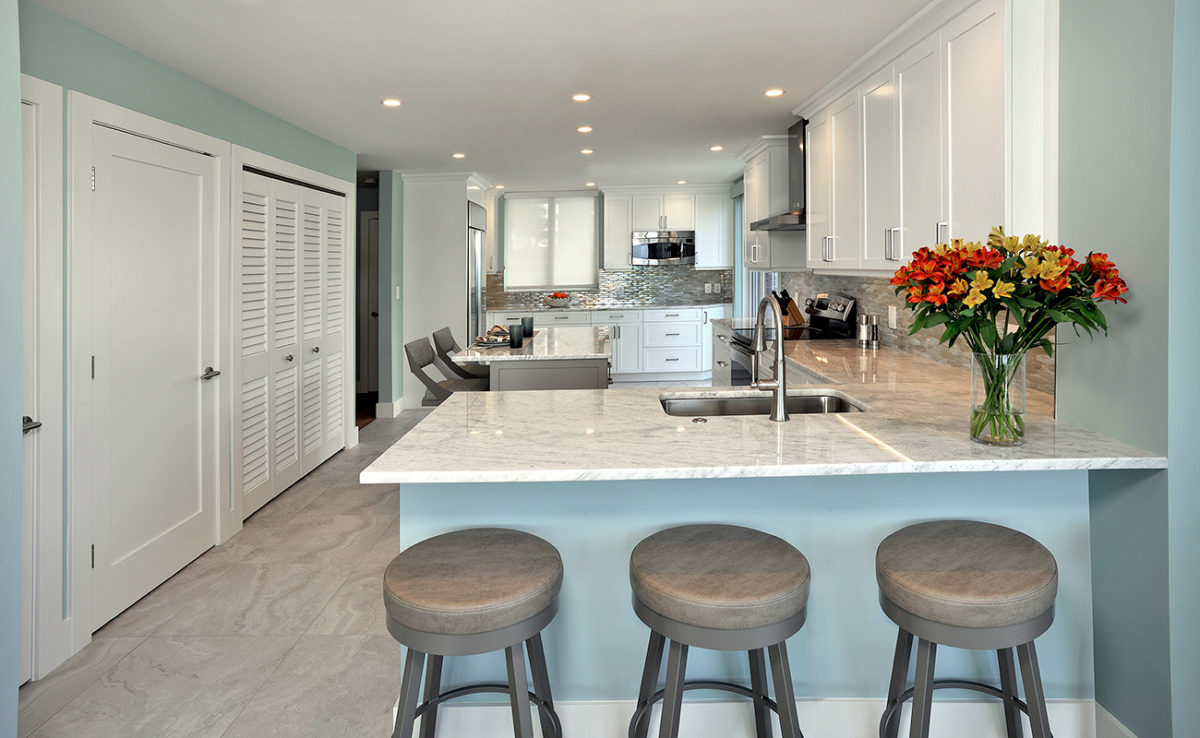 Modern shaker style kitchen cabinets with bar stools