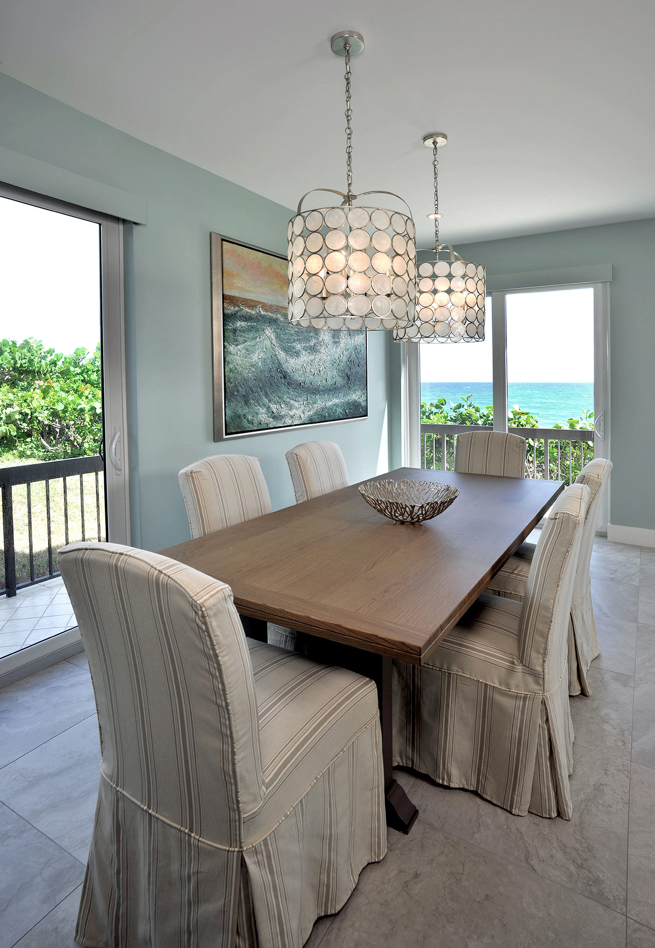 Dining room of beach house showing with beige and sea blues palette for furnishings and fixtures