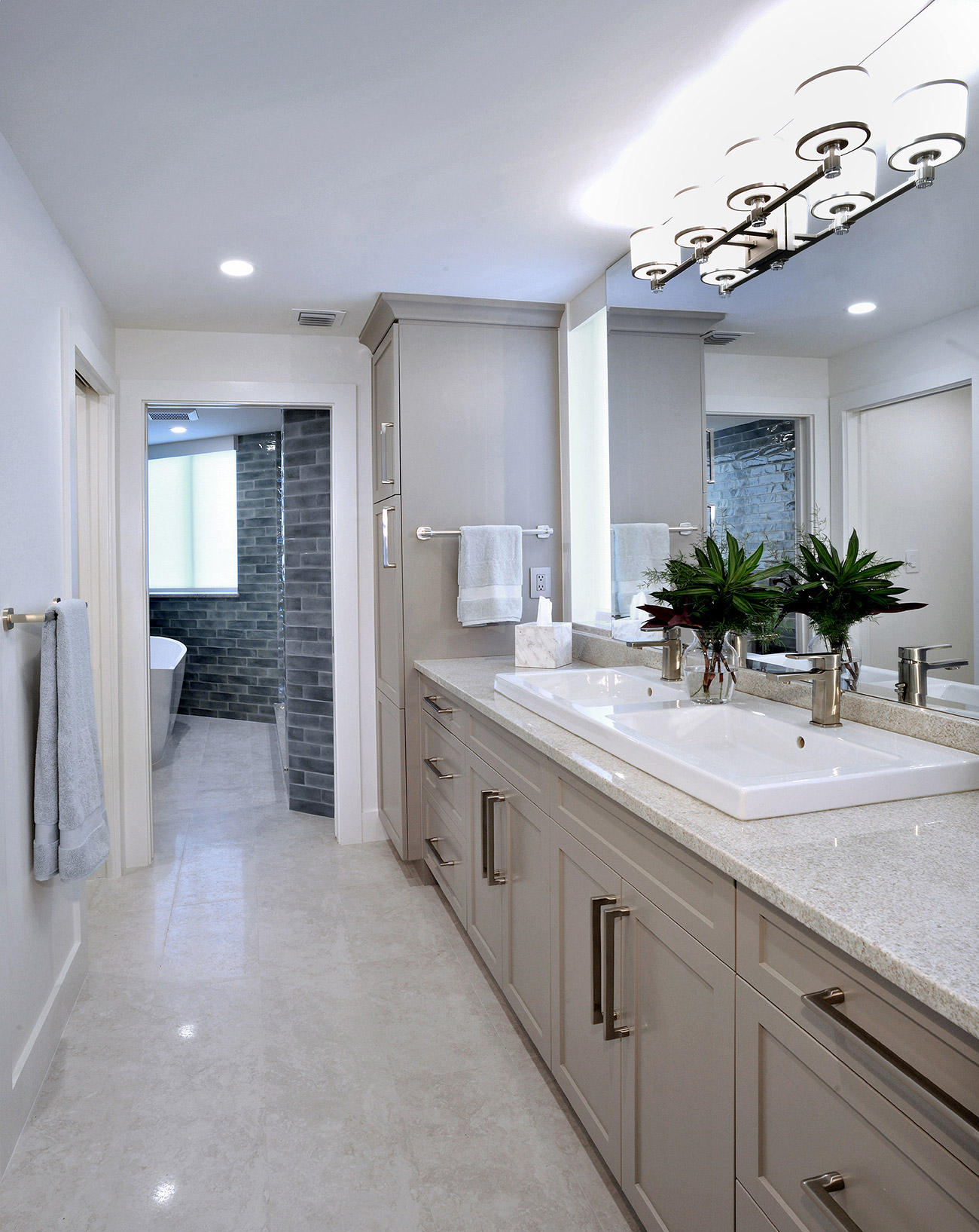 Master bathroom with beige and sandy color palette for shaker style cabinets and double vanity sinks in porcelain white